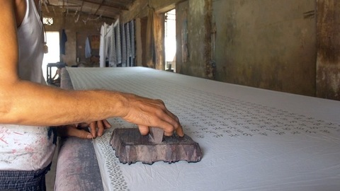 Block Printing - Shot of printing cloth with carved wooden blocks