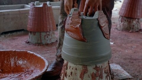 Time lapse of a potter decorating / preparing the cement pot (Gamla)