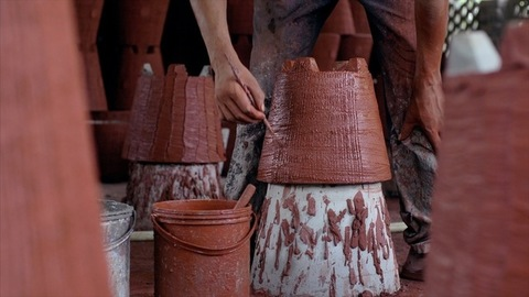 Shot of a potter making design on the pot (Gamla)