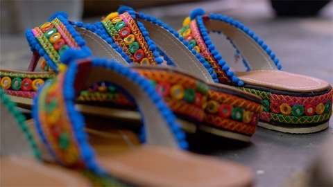 Pan shot of colorful Rajasthani chappal/sandal ready for sale