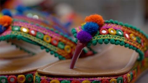 Pan shot of Rajasthani footwear for women