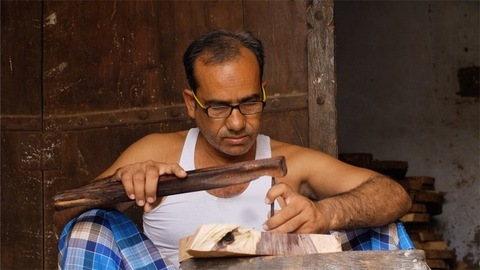 Block Printing - A portrait of a craftsman carving out the wooden stamp in Jaipur