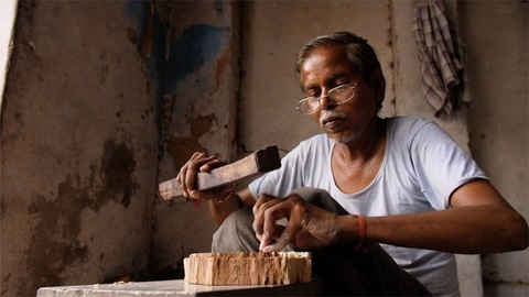Small scale worker making beautiful hand-carved wooden block for block printing