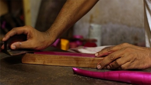 Closeup of the process of making traditional handmade lac bangles in India