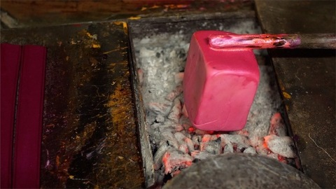 Closeup of the process of melting lac on burning charcoal to make lac bangles