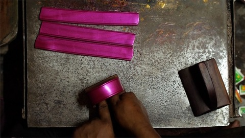 Top view shot of the process of making traditional handmade lac bangles in India