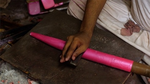 Craftsman rolling the heated lac with the help of wooden tool - Jaipuri Bangle