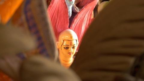 Pan shot - Clay idols of Hindu God Kartikeya and demon Asura at a craft factory