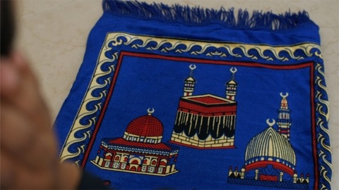 Close-up shot of a Muslim man doing namaz on Jai Namaz - Ramzan, Ramadan