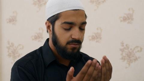 Close-up shot of a Muslim man praying at home during Ramadan - Namaz