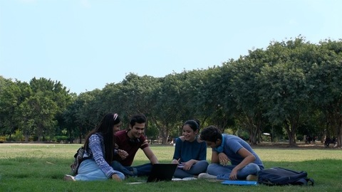 College scene - Group of young friends enjoying during leisure time in the campus