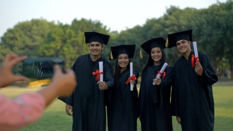 Happy group of young teenagers posing for the photo on convocation ceremony