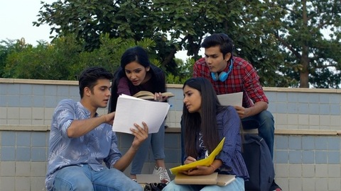 Young college students preparing for their final semester exams - education concept