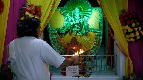 Indian priest worshipping in the temple/mandir of Goddess Durga(Sherawali maa)