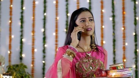Indian married woman telling her husband to come early for Karwa Chauth rituals on a call