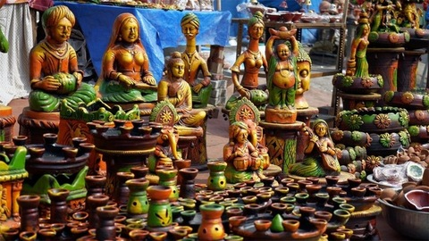 Different types of colorful showpieces and Diwali items in an Indian street market