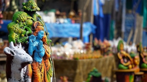 Closeup shot of beautifully handcrafted idols of Radha Krishna - Indian gods