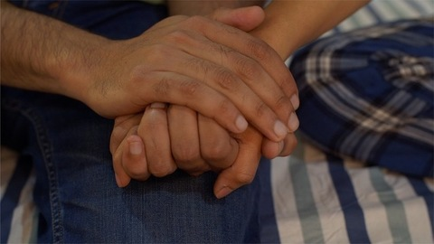 Close-up of Indian man holding lover's hand with care
