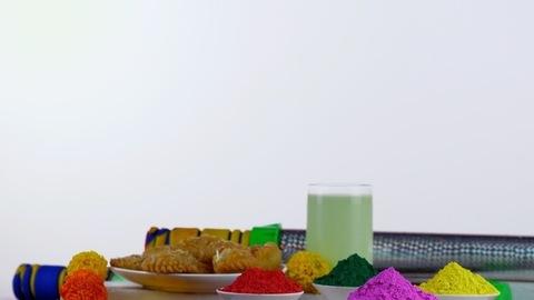 Pan shot of beautifully placed festive items for the joyful Indian festival - Holi