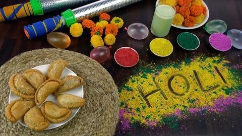 High angle shot of beautifully placed festive items for joyful Holi celebration in India