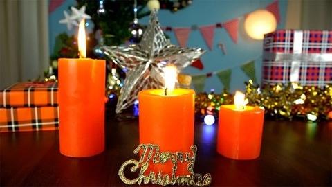 Still shot of burning candles on a decorated Christmas platform - festive scene