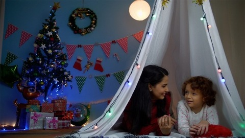 Beautiful Indian mother and son enjoying a perfect fun day during Christmas season