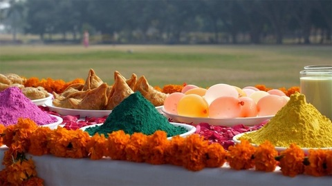 Pan shot of a beautifully decorated festive table for Holi festival celebrated in India