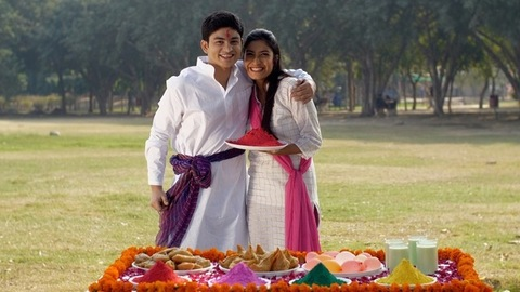 Happy brother and sister celebrating the joyful Holi festival together in India