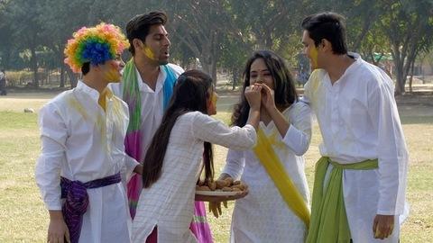 Group of Indian friends enjoying and celebrating Holi festival together - festive scene