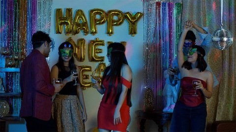 Group of young friends celebrating New Year 2020 with drinks - party concept