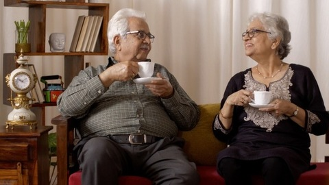 Beautiful old Indian couple having a good time over a cup of tea