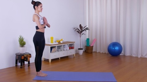 Young sporty woman performing different asanas on a blue mat in sportswear