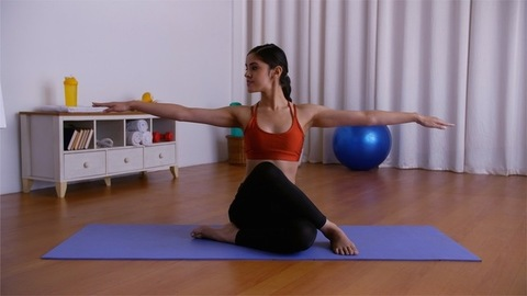 Young yoga professional stretching hands in Dhyana Veerasana on a fitness mat