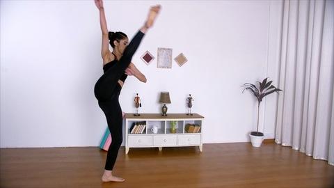 Graceful Indian dancer happily practicing ballet dancing in the living room