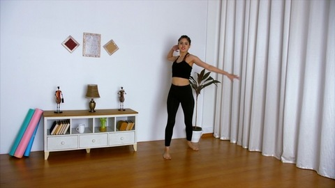 Slow-motion shot of a young sportswoman happily doing a Zumba dance workout