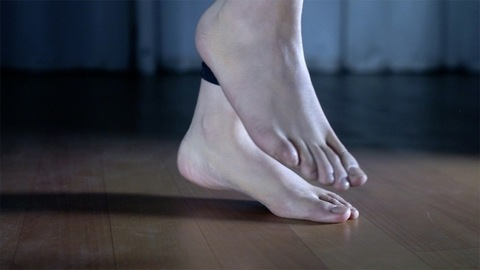 Closeup shot of a young woman's legs jogging barefoot in the place at home