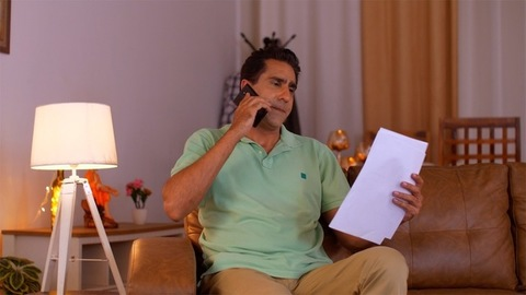 Indian businessman working from home - Talking on the phone
