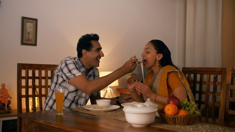 A beautiful moment shared between Indian married couple during lunch / dinner time
