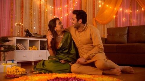 Diwali celebration - Young married couple celebrating first Diwali. Love, Care, Bonding