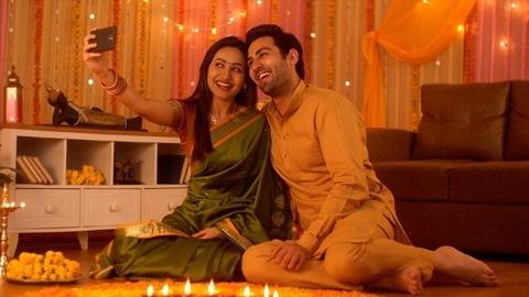 Diwali selfie - Attractive happy young Indian couple taking the selfie