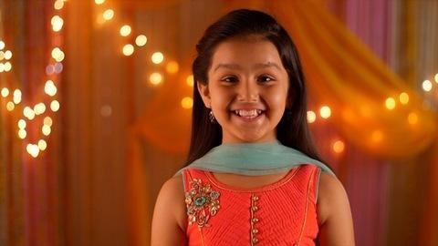 Young girl wearing salwar kameez smiling at the screen - Headshot