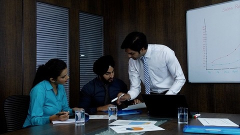 Indian businessman planning a product launch with his team members - Corporate office