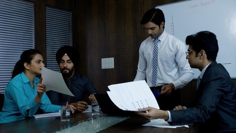 Indian business sales team discussing strategy about their business goals - Sales meet in the conference room