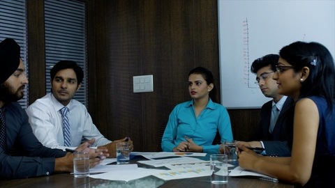 Indian colleagues discussing their upcoming  projects and investment plans - Corporate sector