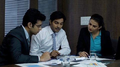 Indian young female meeting with their junior employees in the conference room - Corporate meeting