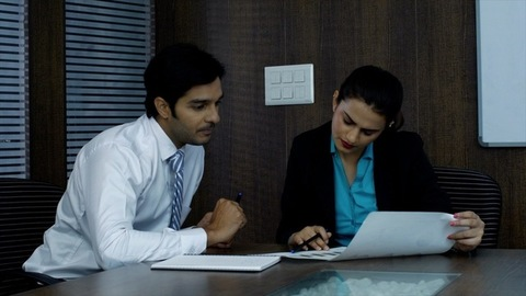 Young Indian employees working together and having a discussion on a new project -corporate sector