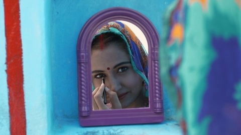 Close up shot of a young woman getting ready to go for work - village life in India