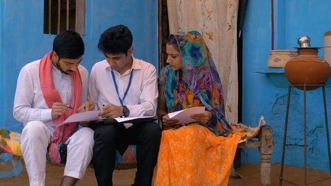 Young village couple getting information about health insurance policy from an agent