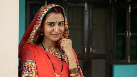 Young beautiful lady in traditional wear smiling and looking into the camera