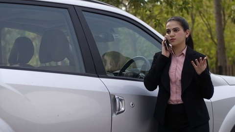 Young Indian woman in formal wear busy over a business phone call - lifestyle office
